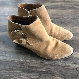 Tan suede ankle booties with gold buckles